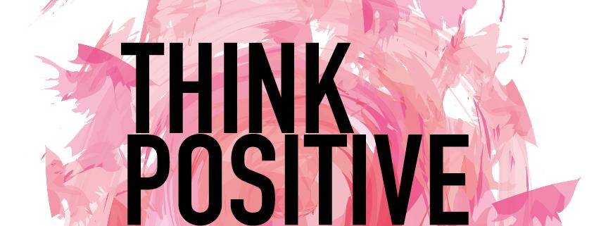 """Symbolbild Positivität: Spruch """"Think positive"""" auf pinkem Hintergrund"""