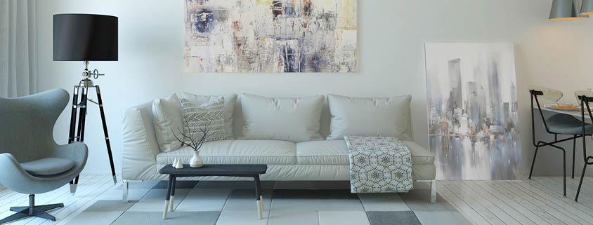 Symbolbild Umfeld: Helles Wohnzimmer mit Möbeln und Bilder
